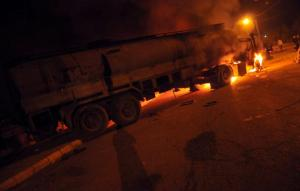 Flames rise from a petrol tanker after it was set on fire by protesters in the northern Lebanese city of Tripoli on 14 March 2013, to halt it from reaching Syria. (Photo: AFP - STR)